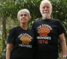 "Camino couple Jane and Dennis Blanchard. Jane writes, ""I recently ordered two Camino shirts. The arrived quickly and are wonderful. The one I am wearing is lighter-weight than the one Dennis Blanchard is wearing. If themed shirts is something you enjoy, consider buying these."""
