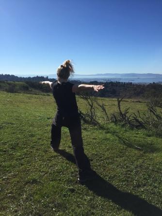Leading standing yoga practice at the ridge