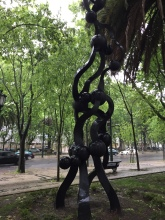 Cool sculptures and palm trees line the Avenida Liberdade