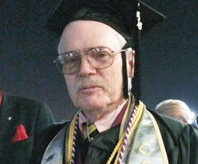 Bruce Guthrie, of Morongo Valley, graduates magna cum laude from California State University at San Bernardino.