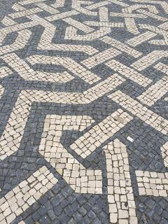 Different patterns of tile on the streets of Lisbon