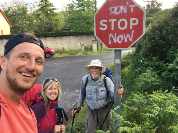 Gayle (pictured center) at the same sign I saw on my longest day of walking, from Padrón to Santiago.