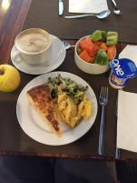 Power brunch at the hotel. Scrambled eggs, tortilla, zucchini, fresh fruit, cafe con leche.