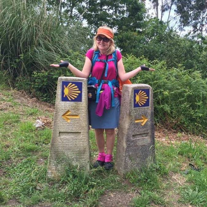 Which way should I go? At a crossroads on the Camino before reaching Santiago.