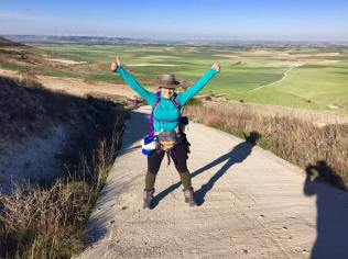 Happy Pilgrim Cathy Seitchik Diaz walk UP the Hill from Castrojerez and back down to the Meseta to Boadilla.