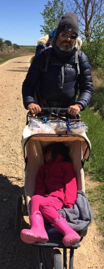 Kyle walking the Camino with 4 year old Scout, to Santiago Compostela