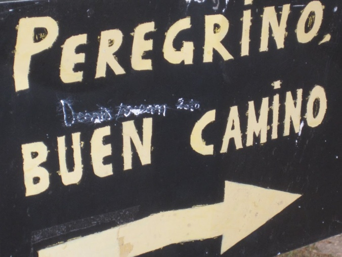 The universal pilgrim greeting (in Spanish) on a sign outside of Santo Domingo on the Camino Francés. Photo courtesy of Guy Joaquin.