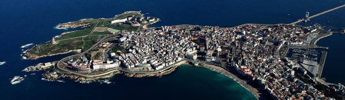 Tower of Hercules is on the left in this photo by Spain.info