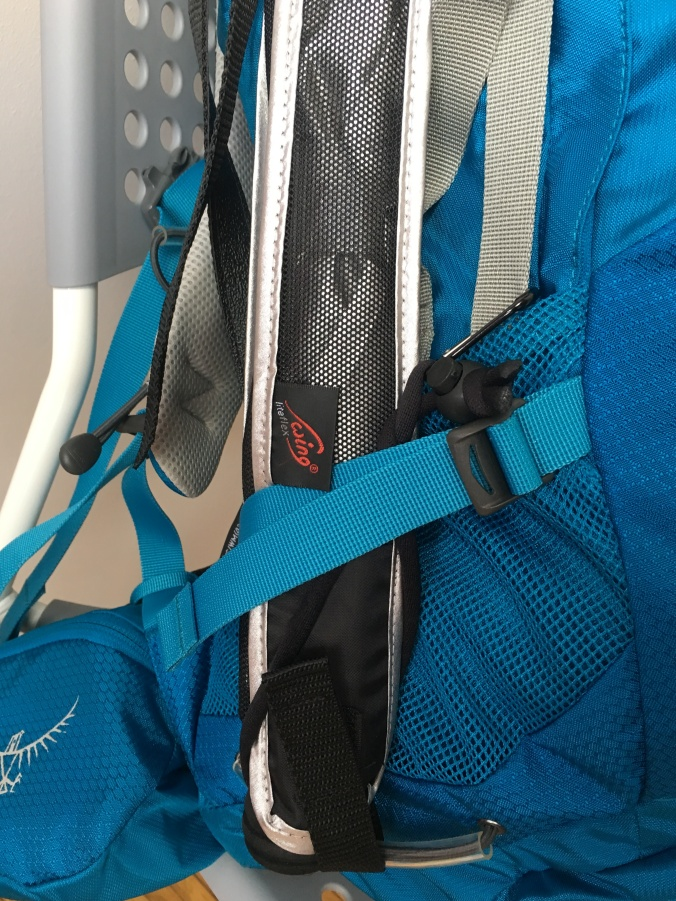 I used the the velcro of the umbrella case, and the strap, along with a carbiner hook to secure it to the straps of my backpack.