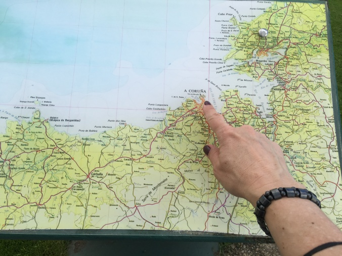 Pointing to A Coruna on the map