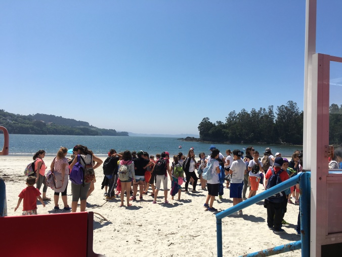 A group of school children arrived at the beach when we were having lunch