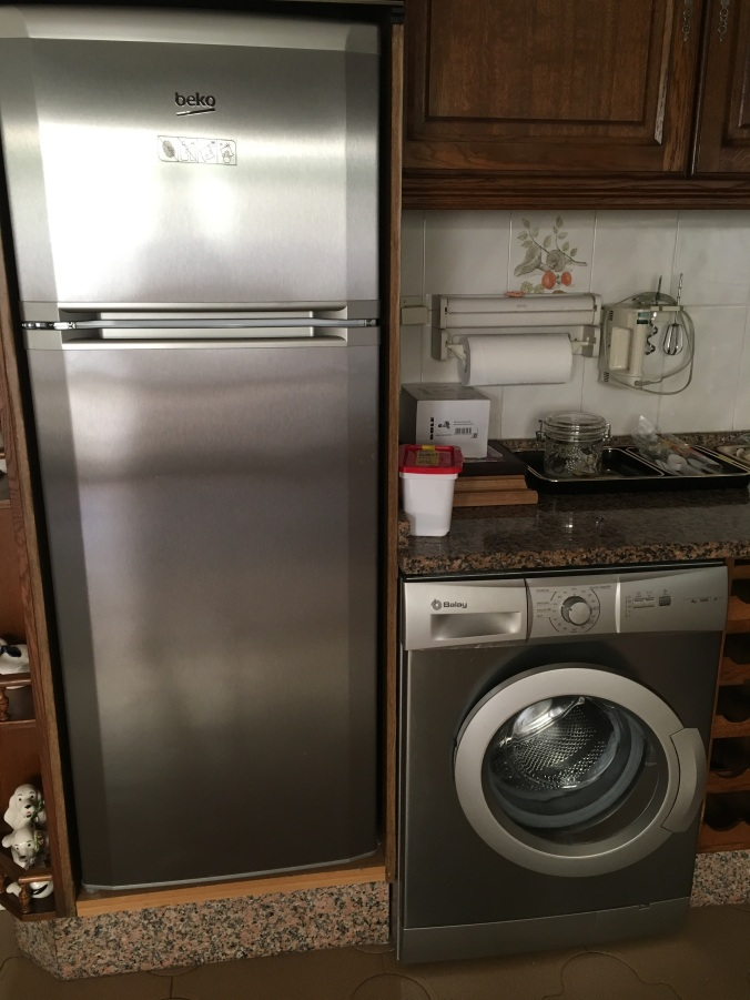 Washing machines are often built into kitchens in Spain and other parts of Europe.