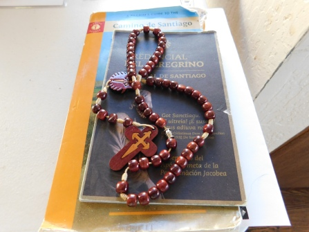 David's rosary, credential, and well-used Brierley guide to the Camino Frances
