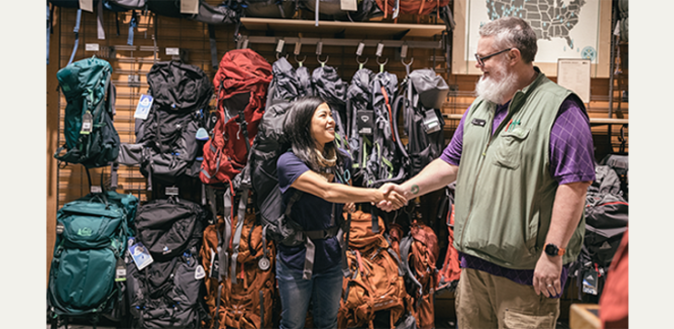 REI customer getting backpack fitting